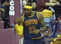 Oct 30, 2014; Cleveland, OH, USA; Cleveland Cavaliers forward LeBron James (23) reacts after scoring a layup while being fouled in the first quarter against the New York Knicks at Quicken Loans Arena. Mandatory Credit: David Richard-USA TODAY Sports